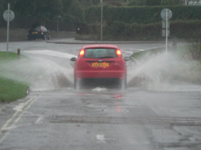 Car driving on flooded road