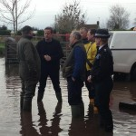 David Cameron  meeting firemen who have been helping the clear-up after serious flooding at Goodings Farm in Somerset.